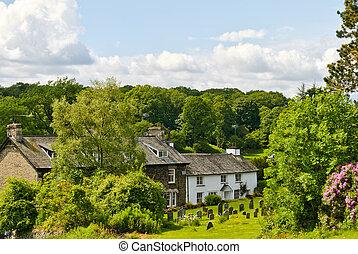 Whitewashed cottage in woodland setting - A whitewashed...