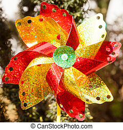 Pinwheel is a simple child's toy made of a wheel of paper or...