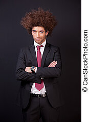 Portrait of a happy and young  business man isolated on black background. Studio shot.