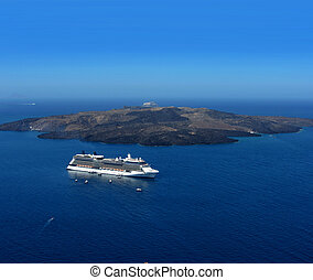 Luxury cruiser in Santorini caldera - Luxury cruiser in blue...