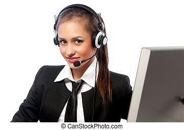 girl with a headset works at the computer