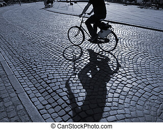 Cyclist in the sunshine - A warm spring afternoon a young...