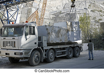 Loading marble Carrara - Marble quarry in the mountains near...