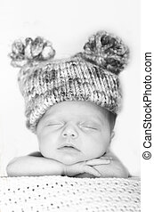 sleeping baby with hat - Newborn child wearing a big hat and...