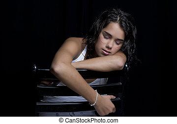 Sleepy head - teenage girl asleep on a chair