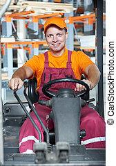 warehouse worker in forklift loader