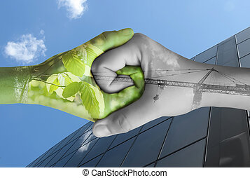 Two hands ecology. Nature and industry together
