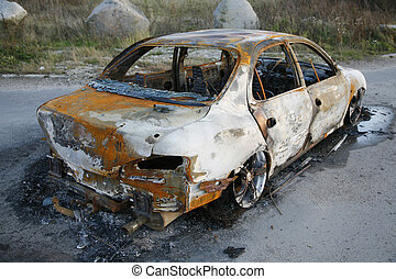 Burnt-out car after car theft.