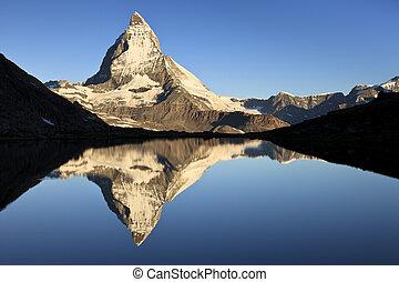 First Light - First light on the Matterhorn, one of the most...