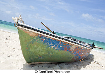 Rowboat - Old rowboat on a beach in the Caribbean.