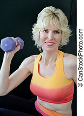 Mature Woman Working Out - Attractive mature woman in the...