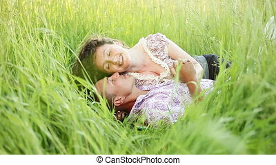 Love couple lies in grass.