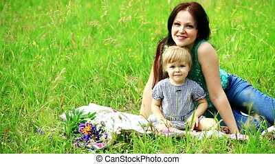 Mother and baby in grass
