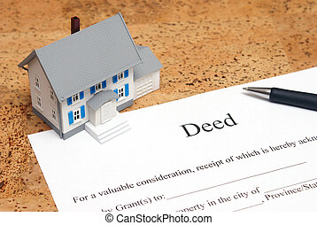 Deed to a House - A scale house on some forms for a deed to...