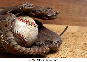 Baseball and Glove - A low contrast image of a well used...