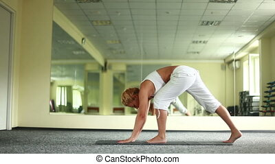 Young adult is doing yoga. Dolly HD