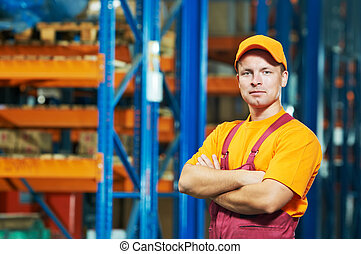 caucasian young manual worker in warehouse - young handsome...