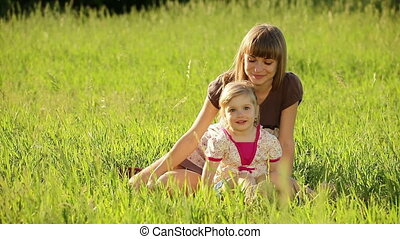 Young mother with child in park