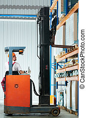 warehouse forklift loader at work - Warehouse worker...
