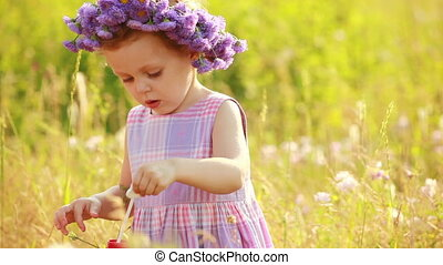 Girl with boubles in the meadow