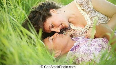 Couple kissing in the grass