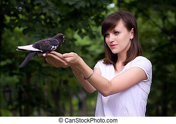 Girl holding a pigeon
