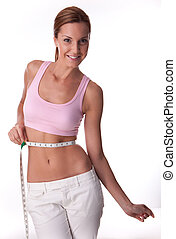 fitness woman on white background measuring her body