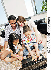 happy young family have fun and working on laptop at home -...