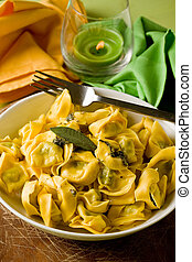 Tortellini with Butter and Sage with green background -...