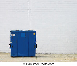 A large blue trash dumpster for waste and refuse disposal in...