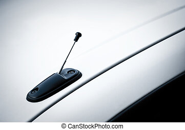 Telescopic antenna on the roof of white car
