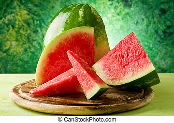 Watermelon - photo of fresh delicious watermelon on chopping...
