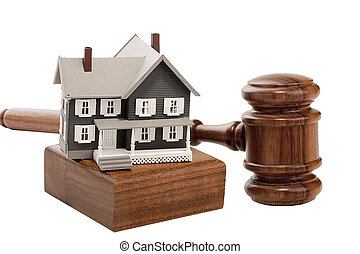 House Foreclosure - Gavel and house model isolated on a...