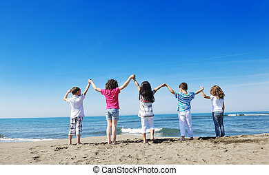 kids playing on beach - happy child kids have fun and play...