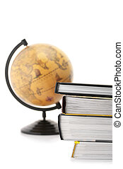 Books and globe - Stack of books and vintage globe on white...