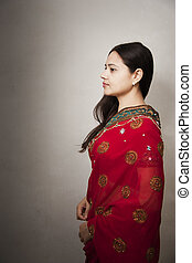 Beautiful Indian happy woman in red