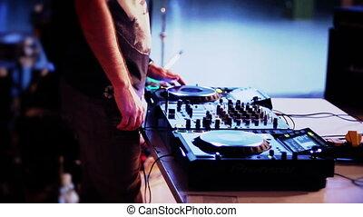 Dj playing in club