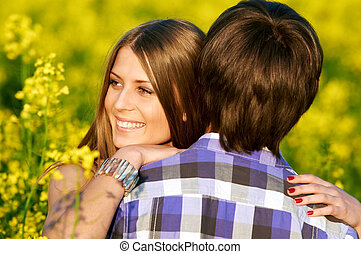 happy young couple - Happy smiling young couple embracing...