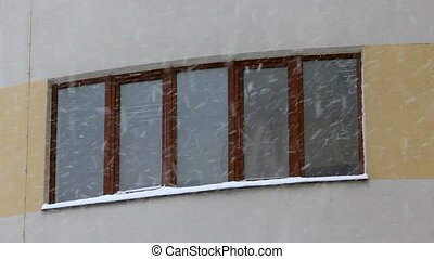 Snowing against the window of an modern house background