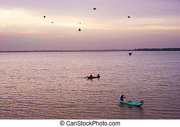 Sri lankan fishermans catching fish at sunset