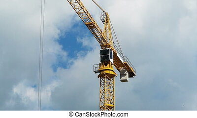 Construction crane against the blue sky