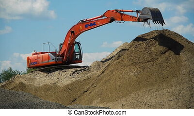 Red excavator working on a construction site