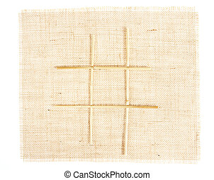 Sackcloth with Tic Tac Toe game pattern with straws on...