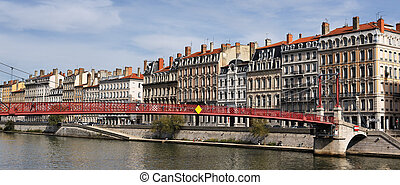 Lyon city with red footbridge in summer