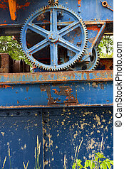 rusty gears - Rusty and blue painted gears for old water dam
