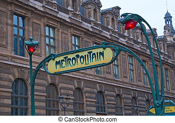 Paris metro old entrance sign near Louvre