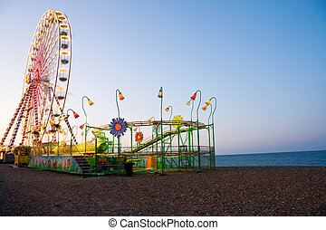 Ferris Wheel at the ocean - Vacation fun - amusement park on...