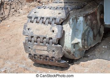 Caterpillar excavator standing on ground in career