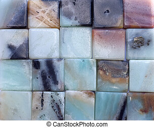 Background of blue and pink square agate gemstones