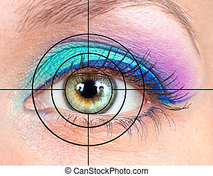 Eye with pink, green make-up and target